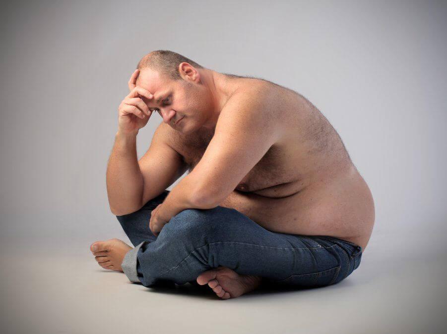 Tučný smutný pán